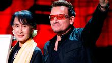 Myanmar's pro-democracy leader Aung San Suu Kyi poses for a photograph with U2's Bono in 2012