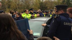 Gardai attended the protest which saw the minister blocked from leaving a community centre in Jobstown, Tallaght. (Photo: Tallaght Says No To Water-Metering/Facebook)