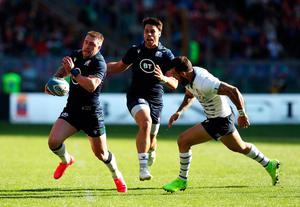 Scotland's Stuart Hogg (left) in action during the Guinness Six Nations win over Italy at the Stadio Olympico, Rome. Photo: Andrew Matthews/PA Wire