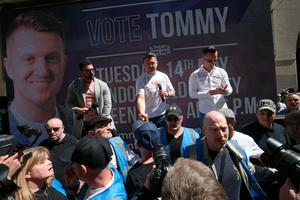 Tommy Robinson speaks to supporters and media outside the Old Bailey  Photo credit: Jonathan Brady/PA Wire