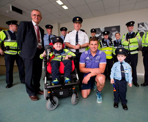 Garda Ceejay McArdle and Garda Jordan Perez with Munster and Ireland rugby star CJ Stander; Niall Maloney, operations director, Shannon Airport; and Chief Superintendent John Kerin. Photo: Sean Curtin