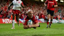 Peter Stringer dives over to score a try for Munster against Biarritz in 2006. Photo: Stu Forster/Getty Images