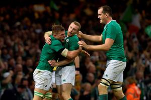 Ireland's flanker Jordi Murphy (L) celebrates with Ireland's centre Keith Earls (C) and Ireland's lock Devin Toner (R) after  scoring his team's second try  during a quarter final match of the 2015 Rugby World Cup between Ireland and Argentina at the Millennium Stadium in Cardiff, south Wales, on October 18, 2015.  AFP PHOTO / LOIC VENANCE  RESTRICTED TO EDITORIAL USE, NO USE IN LIVE MATCH TRACKING SERVICES, TO BE USED AS NON-SEQUENTIAL STILLSLOIC VENANCE/AFP/Getty Images