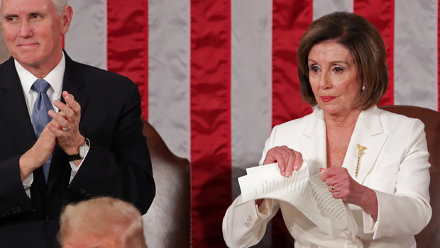 That's torn it: House Speaker Nancy Pelosi rips up her copy of President Donald Trump's State of the Union address. Photo: Reuters