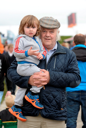 23 Sept 2014; Michael Francis, from Athlone, Westmeath, and his grandson William Redmond, 2. National Ploughing Championships 2014. Ratheniska, Stradbally, Co. Laois. Picture: Caroline Quinn