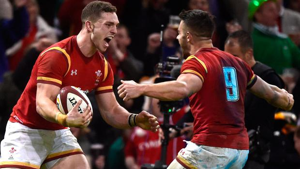 Wales' George North celebrates scoring their second try with Rhys Webb