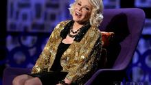 """Joan Rivers greets the audience at the """"Comedy Central Roast of Joan Rivers"""", July 26, 2009, in Los Angeles. Rivers, the raucous, acid-tongued comedian who crashed the male-dominated realm of late-night talk shows and turned Hollywood red carpets into danger zones for badly dressed celebrities, died Thursday, Sept. 4, 2014. She was 81. Rivers was hospitalized Aug. 28, after going into cardiac arrest at a doctor's office (AP Photo/Dan Steinberg)"""