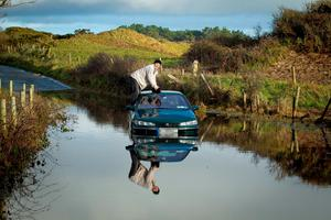 A motorist stranded in flood water near Ennereilly, Co Wicklow, this time last year as the country dealt with extensive flooding Photo: Garry O'Neill