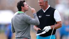 *ALTERNATIVE CROP* Northern Ireland's Rory McIlroy (left) celebrates winning a private bet with Northern Ireland's Darren Clarke during practice day four of the 2014 Open Championship at Royal Liverpool Golf Club, Hoylake. PRESS ASSOCIATION Photo. Picture date: Wednesday July 16, 2014. See PA story GOLF Open. Photo credit should read: David Davies/PA Wire. RESTRICTIONS: Editorial use only. No commercial use. No false commercial association. No manipulation of images. No video emulation.