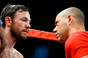 Andy Lee, left, in his corner with trainer Adam Booth last year. The charismatic Booth, who is nicknamed 'Dark Lord' by some and who is known as the Jose Mourinho of fighting by others is an ex-trainer to David Haye