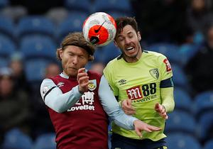 Burnley's Jeff Hendrick and Bournemouth's Adam Smith challenge for the ball. Photo: Reuters