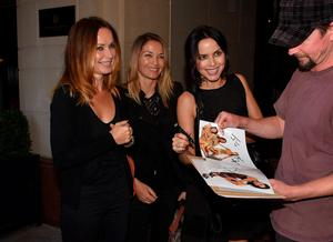 Reformed after ten years apart, The Corrs siblings pose together outside The Westbury Hotel after playing Hyde Park in London last weekend, Dublin, Ireland - 15.09.15. Pictures: Cathal Burke / VIPIRELAND.COM **IRISH RIGHTS ONLY** *** Local Caption *** Sharon Corr, Caroline Corr, Andrea Corr & fan