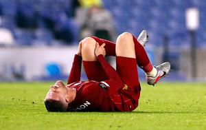 Liverpool's Jordan Henderson reacts after picking up an injury