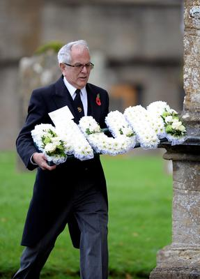 A floral tribute is carried into the funeral of Lynda Bellingham at St Bartholomew's Church in Crewkerne, Somerset Andrew Matthews/PA Wire