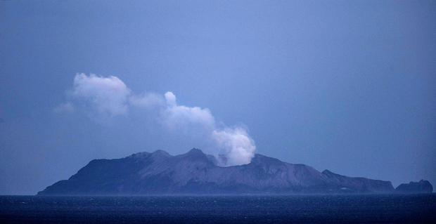 Smoke and ash rises from a volcano on White Island early in the morning on December 9, 2019 in Whakatane, New Zealand. Photo by John Boren/Getty Images