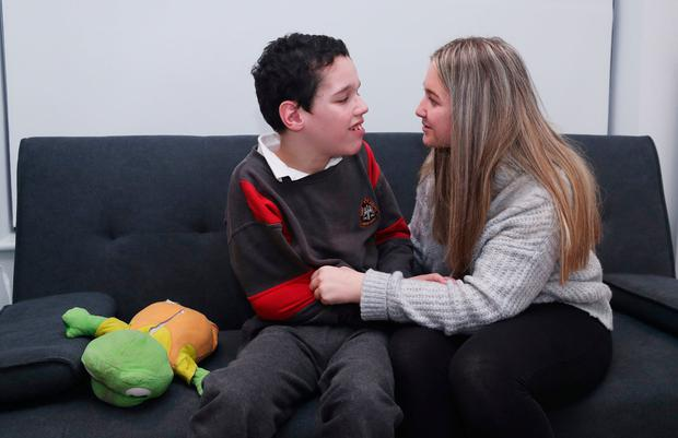 Bond: Carer Shauna Tighe (15) with her brother Daniel (12). Photo: Niall Carson/PA Wire