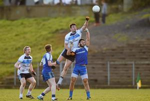 Niall McKeever, UUJ, in action against Neil McAdam, Monaghan