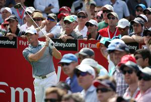 Northern Ireland's Rory McIlroy grimaces after his tee shot at the 14th hole during the second round of the Australian Open