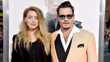 "Amber Heard (L) and Johnny Depp attend the ""Black Mass"" Boston special screening at the Coolidge Corner Theatre on September 15, 2015 in Boston, Massachusetts.  (Photo by Paul Marotta/Getty Images for Warner Brothers)"
