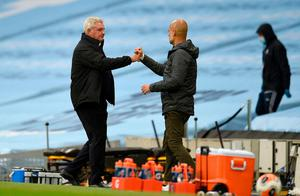 Newcastle United manager Steve Bruce with Manchester City's Pep Guardiola following the match. Photo: Oli Scarff/Pool via Getty Images
