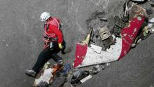 A French rescue worker inspects the remains of the Germanwings Airbus A320 at the site of the crash, near Seyne-les-Alpes, French Alps. Reuters/Gonzalo Fuentes/Files