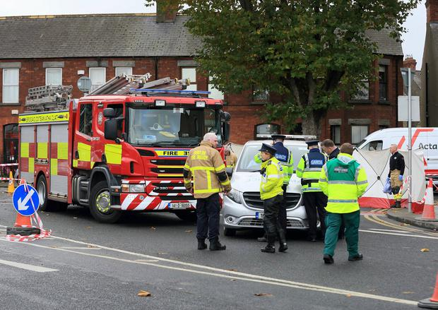 Garda and members of Dublin Fire Brigade pictured at the scene of a fatal road traffic accident where a cyclist was fatally injured. Photo: Frank McGrath