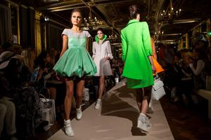 Models present creations by designer Paul Costelloe during their 2016 spring / summer catwalk show at London Fashion Week in London