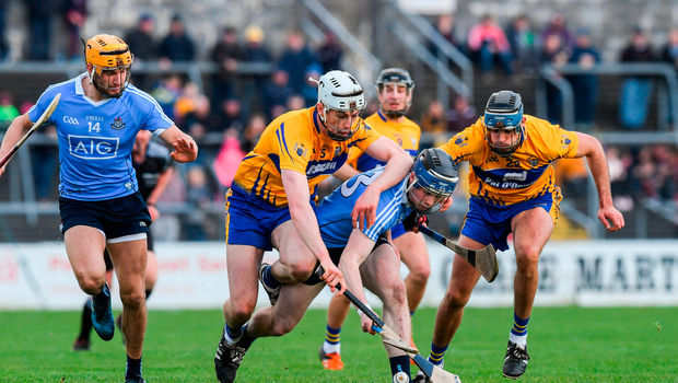 Fiontán McGibb and Eamon Dillon of Dublin in action against Conor Cleary and Brendan Bugler of Clare