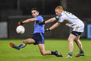 Dublin's Niall Scully send the ball forward ahead of Brian Crombie's challenge.