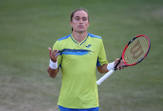 Alexandr Dolgopolov of Ukraine reacts in his match against Yen-Hsun Lu of Chinese Taipei during their quarter final match on day five of the Aegon Open Nottingham at Nottingham Tennis Centre on June 25, 2015 in Nottingham, England. (Photo by Jan Kruger/Getty Images for LTA)