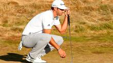 Dustin Johnson lines up a putt on the 18th hole during the final round of the 115th U.S. Open Championship