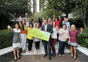 The Donegal 'Lucky 13' picking up their cheque from Lotto headquarters yesterday