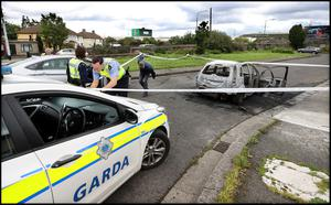 Gardai preserve the scene where a car was burnt out close to the scene of the fatal shooting in Ballyfermot. Photo by Steve Humphreys 27th July 2020