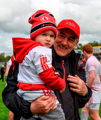 Tyrone manager Mickey Harte celebrates with his two-year-old grandson Michael Harte after the Ulster SFC quarter-final at Celtic Park. Pic: Sportsfile