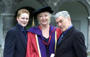 Broadcaster Marian Finucane with husband John Clarke and son Jack after she was conferred with an honorary doctorate by DIT in 2002. Photo: Tom Burke