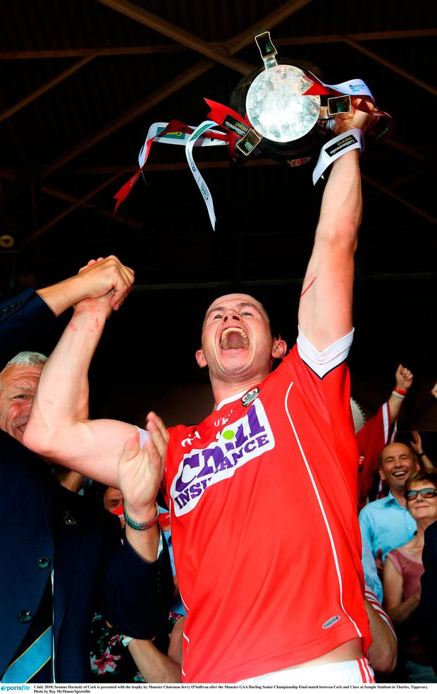 Seamus Harnedy of Cork is presented with the trophy by Munster Chairman Jerry O'Sullivan after the Munster GAA Hurling Senior Championship Final match between Cork and Clare at Semple Stadium in Thurles, Tipperary. Photo by Ray McManus/Sportsfile