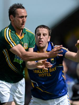 Meath's Graham Reilly battles Wicklow's Paul McLoughlin for control of the ball