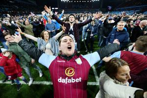 Aston Villa fans celebrate on the pitch after the match Action Images via Reuters / Carl Recine