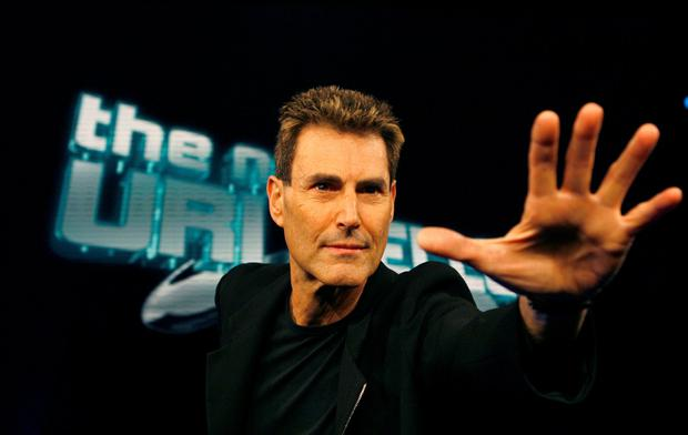 FILE PHOTO: Israeli psychic Uri Geller poses for photographers in Cologne January 6, 2008. REUTERS/Ina Fassbender (GERMANY)/File Photo