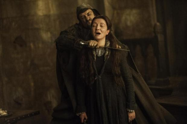 Catelyn Stark is murdered in a bloody scene from The Rains of Castamere episode of Game of Thrones. Photo: Game of Thrones / HBO