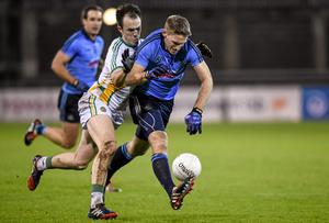 Eoghan O'Gara, Dublin, under pressure from Offaly's Graham Guilfoyle.