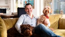 Karl Henry at home with his two dogs. Photo: Fran Veale