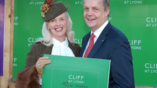 """Gillian Gilbourne from Mill Street in Cork is congratulated by Adriaan Bartels -General Manager at Cliff House Hotel Collection after winning """"The Cliff at Lyons Style Stakes"""" at the  Leopardstown Christmas Racing  Festival. Pictures:Brian McEvoy"""