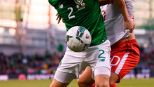 Seamus Coleman of Republic of Ireland in action against Ethan Britto of Gibraltar