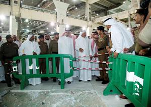 Saudi officials stand near damage caused by a collapsed crane at the Grand Mosque in the Muslim holy city of Mecca, Saudi Arabia September 11, 2015. At least 107 people were killed when a crane toppled over at Mecca's Grand Mosque on Friday, Saudi Arabia's Civil Defence authority said, less than two weeks before Islam's annual haj pilgrimage. REUTERS/Stringer