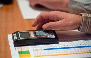 A delegate prepares to vote using the new electonic system during the GAA Annual Congress 2015.