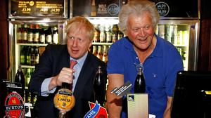Tim Martin, chairman of JD Wetherspoon (right), with UK Prime Minister Boris Johnson (Henry Nicholls/PA)