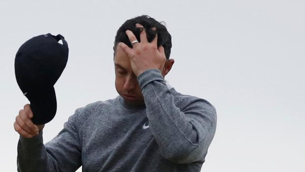 Rory McIlroy reacts after not making the cut