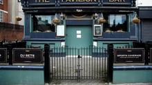 A closed pub in Belfast. Photo: REUTERS/Jason Cairnduff/File Photo