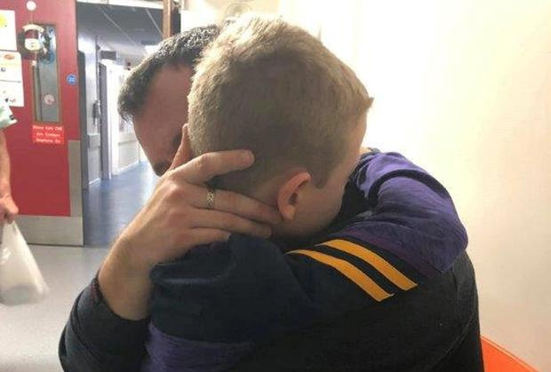 Tommy is comforted by his father Gary after he is told his heart operation was cancelled for the eighth time